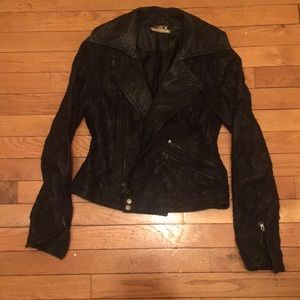 One of a kind lace covered leather jacket